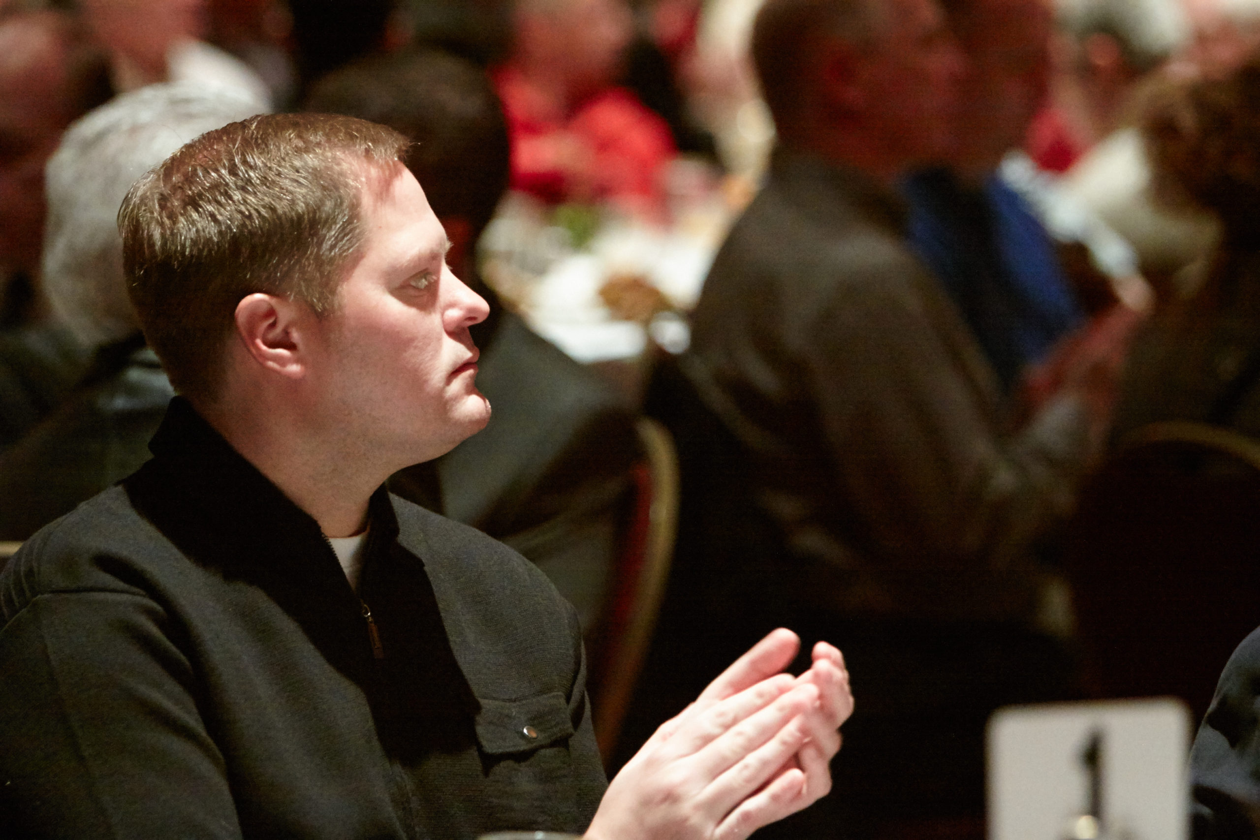 Man clapping | Omaha Leadership Prayer Breakfast