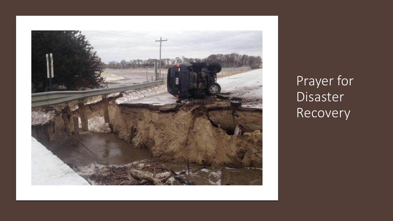 Picture of washed out rod due to a flood | Pray for Disaster Recovery